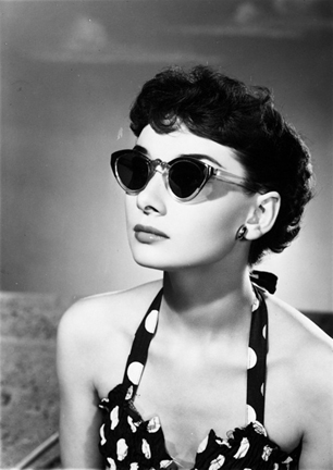 Audrey Hepburn in 1960s cat eye shades.