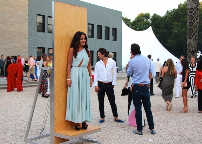 Designer Jill Stuart stands on installation