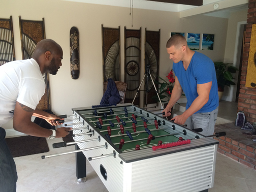 Dimitry challenges Greg to a game of Foosball. Guess who won!