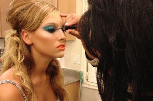 Makeup artist Leibi Carias applying the finishing touches to our look.