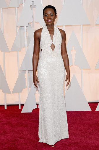 Lupita Nyong'o in a white pearl beaded Dior at the Oscars 2015
