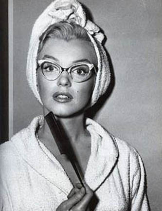 Maryilyn Monroe in cat eye glasses.