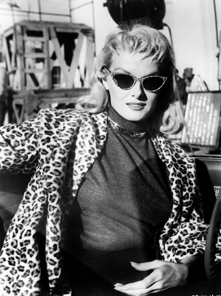 Actress, Jane Russell in cat eye shades.